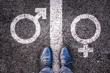 Genderteken op asfalt